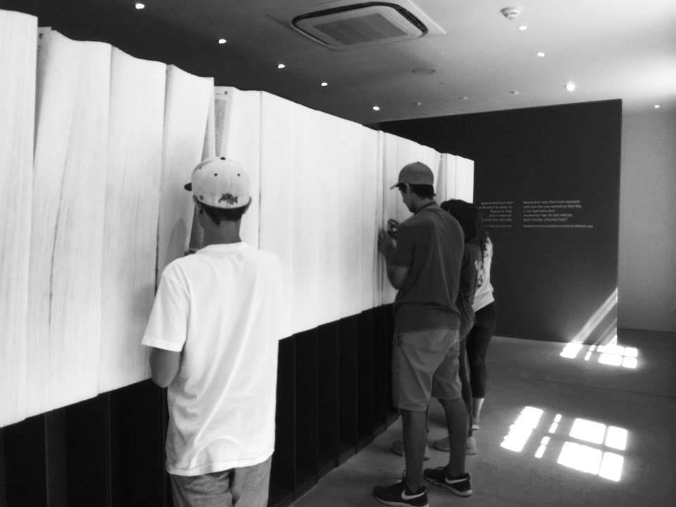 Tour members searched for names of the missing and dead.