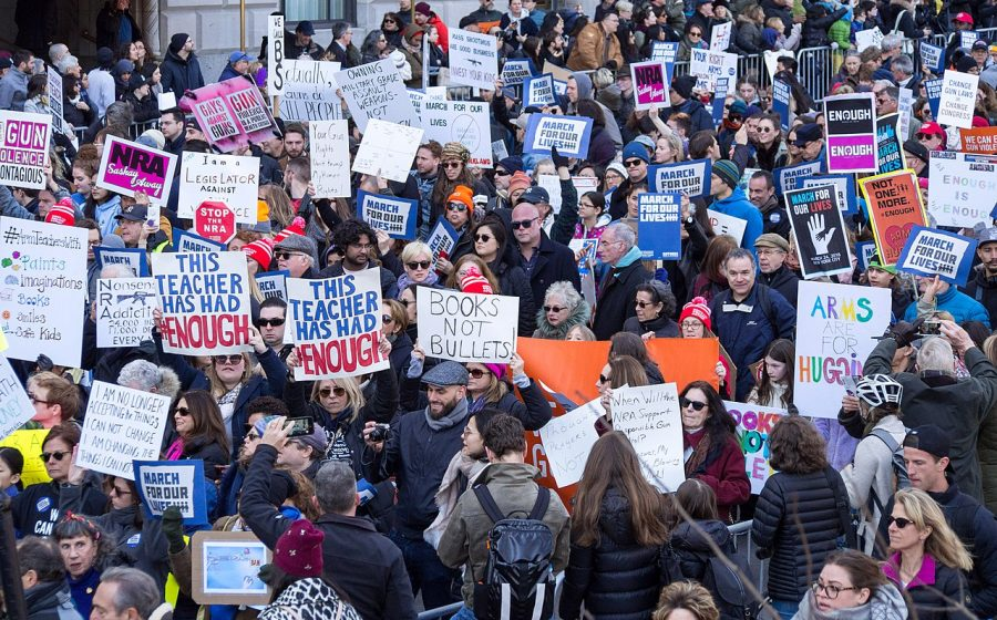 Students gathered with adults to protest against gun violence in cities across the world Saturday.