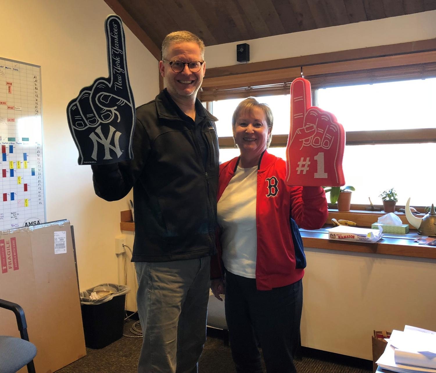 Executive Director Dr. Anders Lewis and Principal Ellen Linzey have let their rivalry strengthen their friendship.