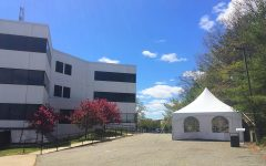 A tent next to the White Building serves as an intake area, lunch area, and place for a mask break.